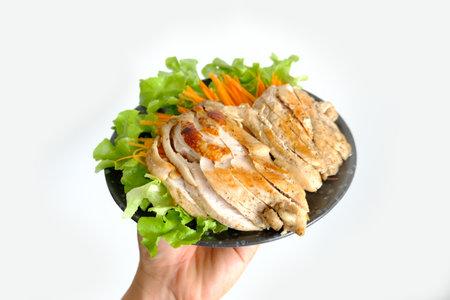 Grilled boneless breast on black dish 免版税图像