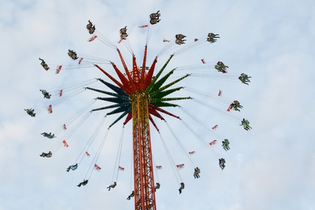 chairoplane: fun fair attraction chairoplane with cloudy sky