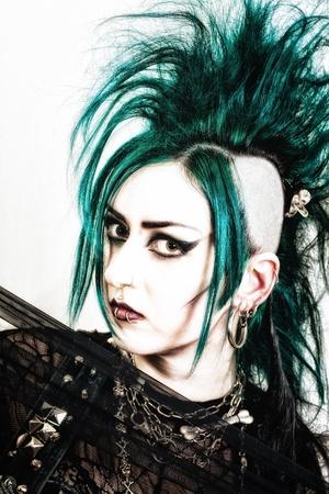 sidecut: green haired postpunk girl on white background