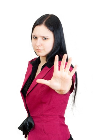 self defense: Young businesswoman making Stop gesture