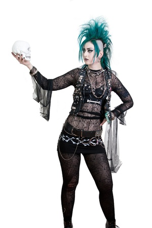 green haired postpunk girl with a skull in her hand  All on white background Stock Photo