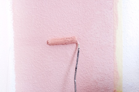 painting a wall in pink photo