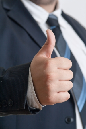 closeup of Businessman showing thumb up gesture Stock Photo - 13653778