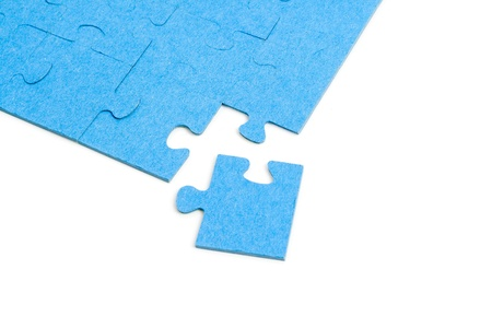 Blue Puzzle isolated on white background photo