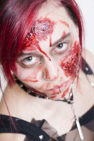 Red Haired Gothic Girl bleeding after accident photo
