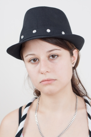 Portrait of young brunette girl wearing a black hat Stock Photo - 14768610