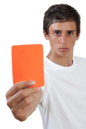 young swarthy man with  brown eyes showing red card photo