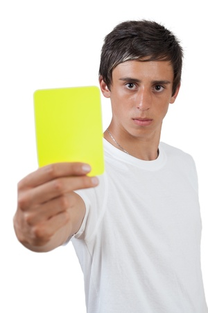 swarthy: young swarthy man with  brown eyes showing yellow card Stock Photo