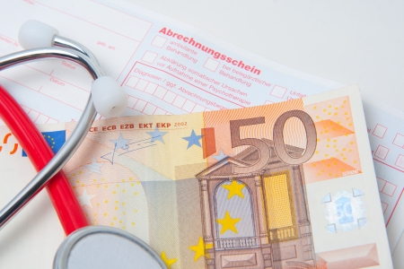 stethoscope and european currency on a german medical bill photo