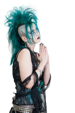 green haired postpunk girl praying on white background