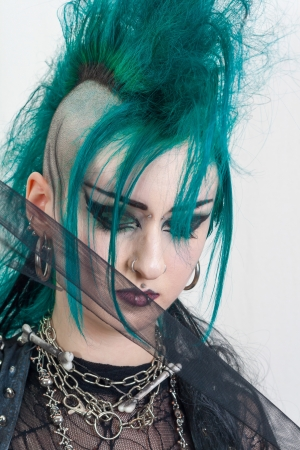 sidecut: green haired postpunk girl on grey background