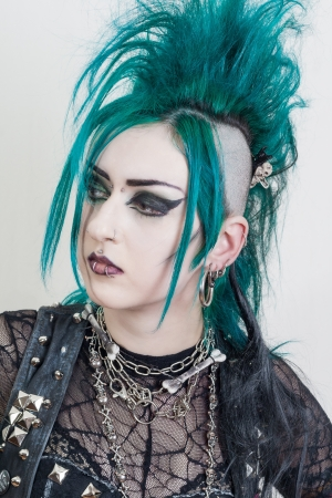 green haired postpunk girl on grey background
