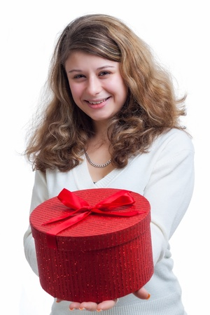beautiful smiling blond woman holding a red gift box isolated on white Stock Photo - 16634663