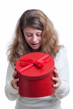 beautiful smiling blond woman opens a red gift box isolated on white Stock Photo - 16634664