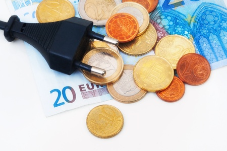 Isolated Power plug with European Banknote and coins - electricity costs concept photo