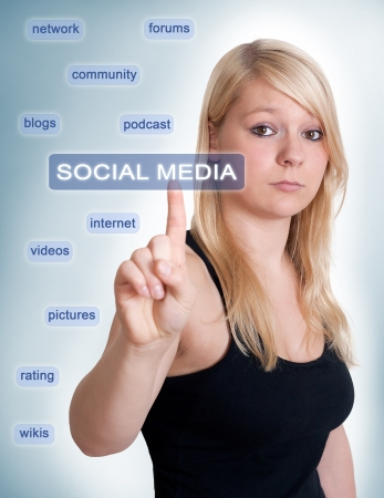 Blonde woman thinking about social media Stock Photo - 17422340