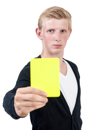Attractive young man showing yellow card  - isolated on white background Stock Photo - 17422342