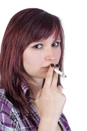 young red haired woman is smoking a cigarette - isolated on white background photo