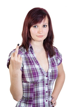 young red haired woman showing the finger / flip the bird at somebody - isolated on white background photo