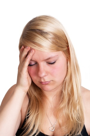 splitting headache: young blonde woman with splitting headache - isolated on white background Stock Photo
