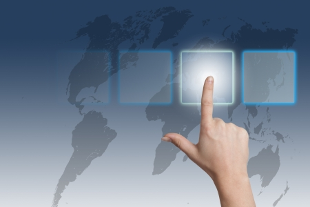 hand pressing a touchscreen button on blue-white world map background photo