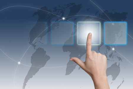 hand pressing a touchscreen button on blue-white world map background Stock Photo - 19131578