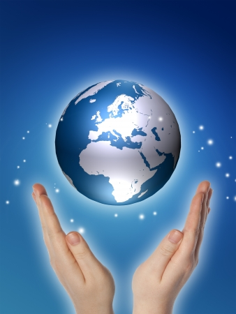 environmental safety: world or globe in your hands on blue background