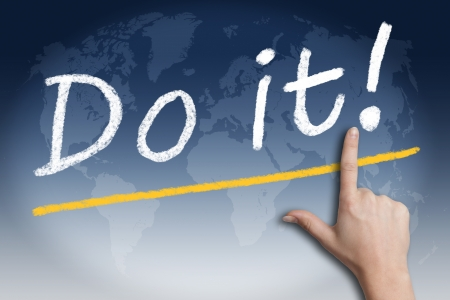 """Motivation text """"Do it!"""" with a hand pointing to it on blue background with a world map"""