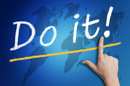 Motivation text 'Do it!' with a hand pointing to it on blue background with a world map photo