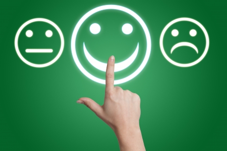 woman hand pointing to a positive feedback button on green background Stock Photo - 19460205