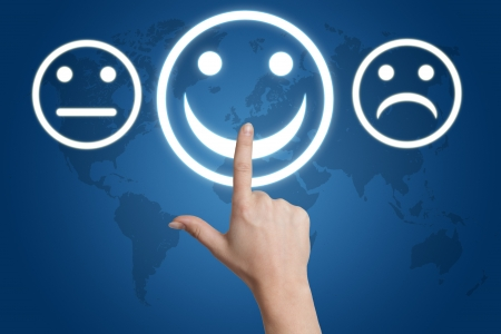 woman hand pointing to a positive feedback button on blue background with world map Stock Photo - 19460202