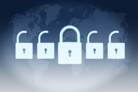security concept - Locks on blue background with world map photo