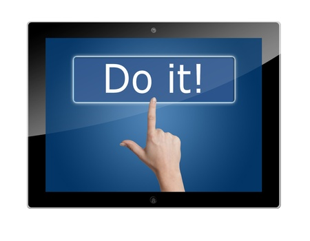 Tablet PC with Woman hand pressing a button with word ' do it! ' on blue background photo