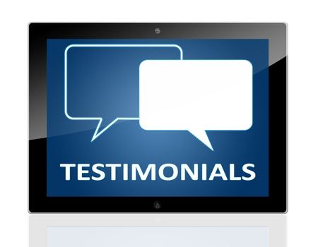 testimonials: Tablet PC with chat symbols and word testimonials on blue background - isolated on white background Stock Photo