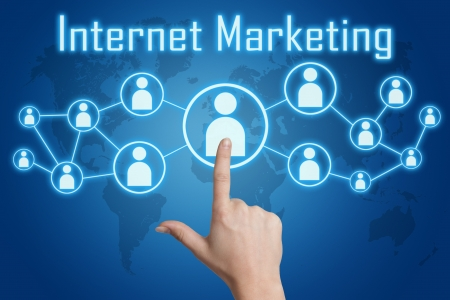 woman hand pressing internet marketing icon on blue background with world map photo