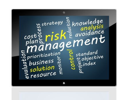 Tablet concept: Risk management in word tag cloud photo