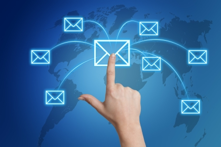 Communication concept: Hand pressing a letter icon on a world map interface Stock Photo - 21004455