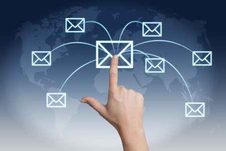 Communication concept: Hand pressing a letter icon on a world map interface Stock Photo - 21004457