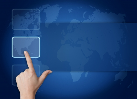 hand pressing a touchscreen button on blue background with world map photo