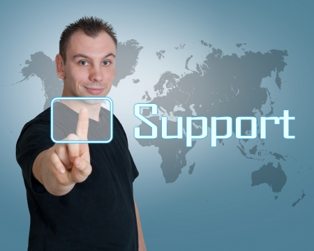 Young man press digital support button on interface in front of him