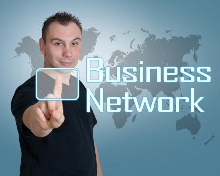 Young man press digital Business Network button on interface in front of him Stock Photo - 24470882