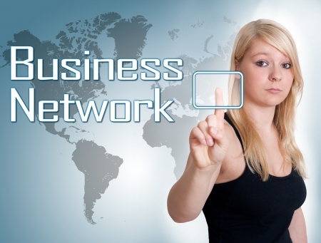 Young woman press digital Business Network button on interface in front of her Stock Photo - 24470907