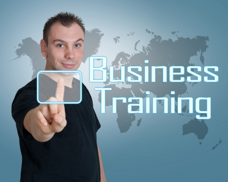 knowlage: Young man press digital Business Training button on interface in front of him