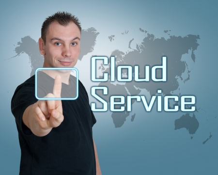 Young man press digital Cloud Service button on interface in front of him photo