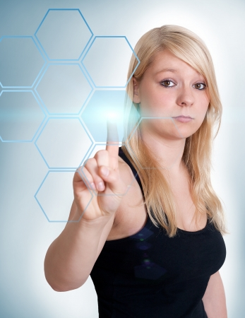 Blond woman pressing group of buttons with one hand photo