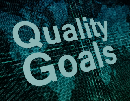 Quality Goals text concept on green digital world map background  photo
