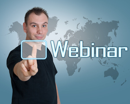 Young man press digital Webinar button on interface in front of him Standard-Bild