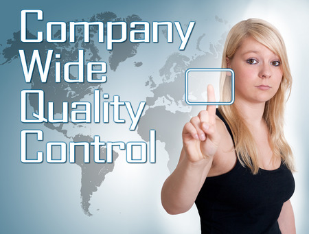 product design specification: Young woman press digital Company Wide Quality Control button on interface in front of her