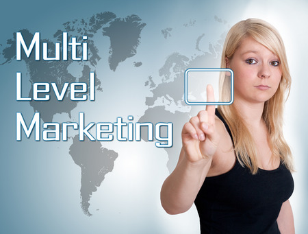 multi level: Young woman press digital Multi Level Marketing button on interface in front of her
