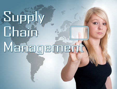 Young woman press digital Supply Chain Management button on interface in front of her photo